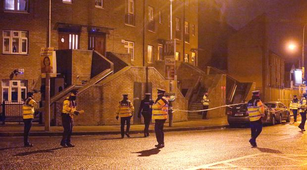 Garda swarm around the scene on Poplar Row in north inner city Dublin where Eddie Hutch was shot