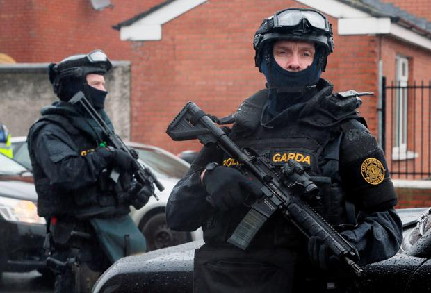 Armed gardaí from the Emergency Response Unit on patrol in north inner city Dublin after Gerry Hutch Snr's death. PA