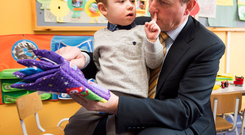 Myles Motuza gets close to Taoiseach Enda Kenny at Daisy Chain Daycare creche in Clochran, Tuam. Photo: Andrew Downes