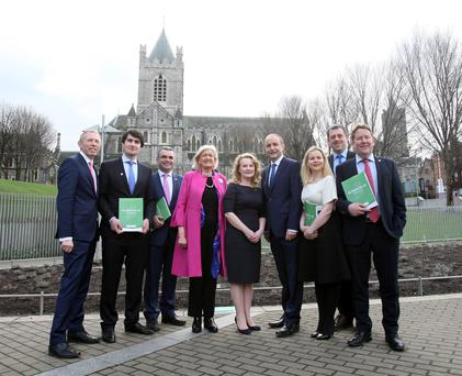 Fianna Fail leader Micheál Martin with members of the Oireachtas party and candidates, from left: Timmy Dooley, Jack Chambers, Dara Calleary, Senator Mary White, Mary Fitzpatrick, Lorraine Clifford-Lee, Senator Thomas Byrne and Senator Darragh O'Brien at the launch of the Fianna Fáil manifesto at Wood Quay, Dublin, yesterday. Photo: Tom Burke