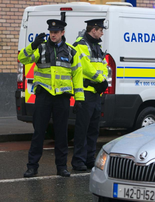 Gardaí at a checkpoint on Cork Street in Dublin yesterday. Photo: Collins