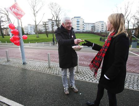 Alex White meeting voters on Valentine's Day in his constituency. Photo: Leon Farrell/Photocall Ireland
