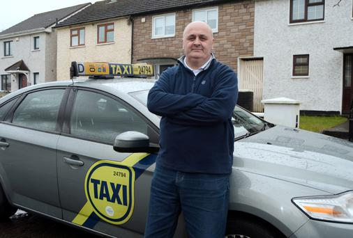 David Milne from Finglas in Dublin says he could lose his taxi plate because of insurance hikes. Photo: Caroline Quinn
