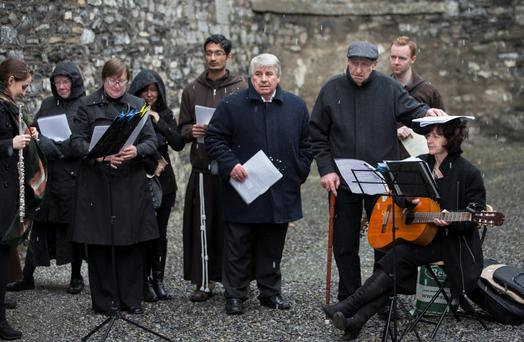 Hailstones fall during the ceremony for the priests who delivered the last rites to 1916 leaders at Kilmainham Gaol. Photo: Fergal Phillips