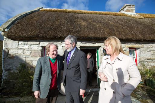 Sinn Féin president Gerry Adams and candidate Rose Conway Walsh meet Tom Hennigan on the campaign trail. Photo: Keith Heneghan