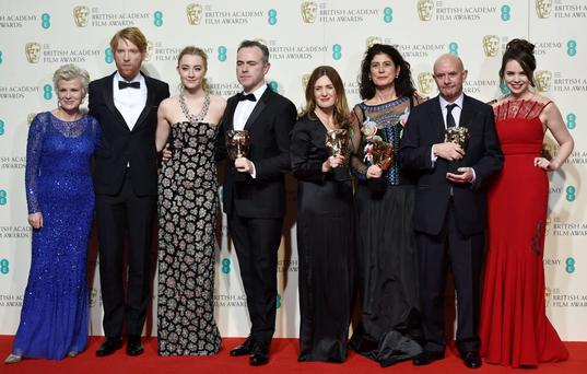 At the Baftas with awards for Outstanding British Film were (left to right) 'Brooklyn' actors Julie Walters, Domhnall Gleeson, and Saoirse Ronan; director John Crowley; producers Finola Dwyer and Amanda Posey; writer Nick Hornby, and actor Eileen O'Higgins. Photo: Reuters/Toby Melville