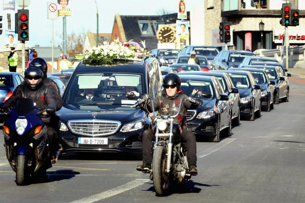 The funeral cortege makes its way to Harold's Cross.
