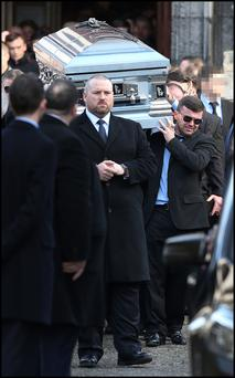 David Byrne's coffin is carried from the church.