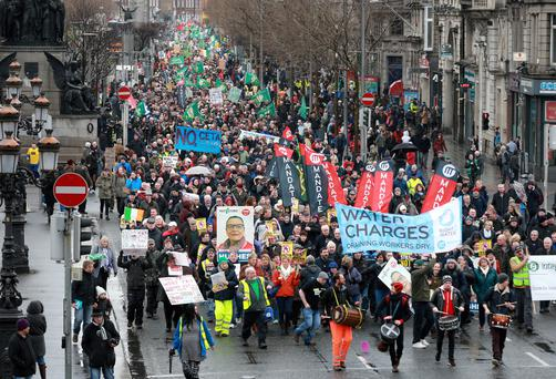 MAKING A SPLASH: The Right2Water protesters make their way down Dublin's O'Connell St yesterday. Photo: Frank McGrath
