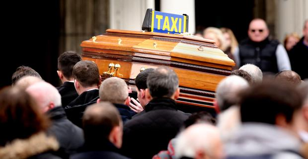 FUNERAL: Mourners carry the remains of slain taxi driver Eddie Hutch Snr after he was gunned down in an attack at his Ballybough home in Poplar Row, Dublin by a four-man hit-team following the murder of David Byrne in the Regency Hotel