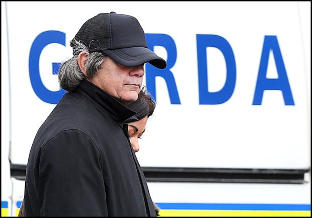 COVERED UP: Gerry 'The Monk' Hutch keeps his cap tugged down over a grey wig as he attends his brother's funeral