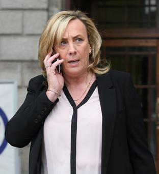 Louise Byrne, from Mulhuddart, Dublin, leaves court after she was awarded €75,000 damages. Photo: Collins