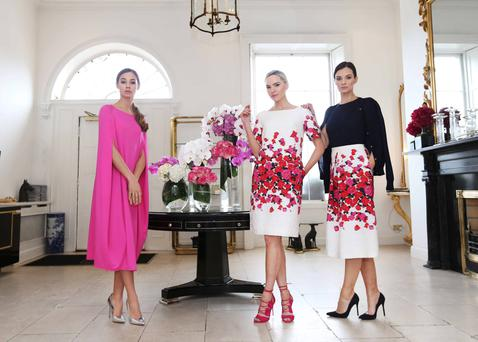 Left to right: Thalia wears Palma Jersey Dress in Hello pink (€995); Sarah is in Rosa Dress (€1,495) in pink and red embossed rose-print silk; and Karen wears a Rosette pink and red embossed rose-print silk skirt (€1,395), Justine navy knit (€495) and Philippa navy sweater (€395). Photography: Sasko Lazarov/Photocall Ireland