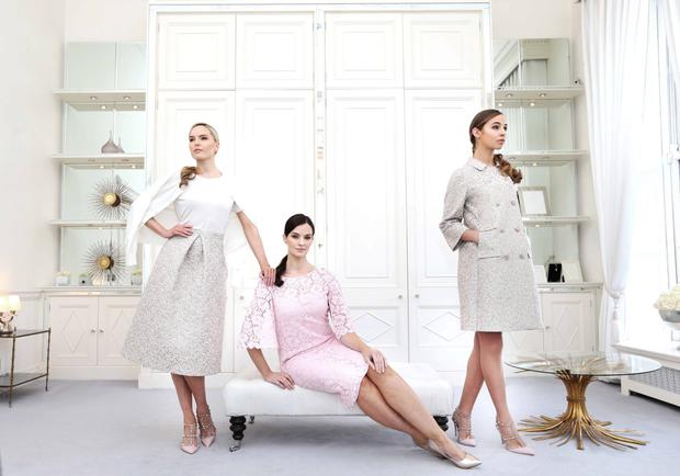 Left to right: Sarah is in Lianna skirt in Blossom gold brocade (€1,295), Justine ivory knit (€495) and Philippa ivory sweater (€395); Karen wears Ravena pink floral lace dress with cape sleeve (€1,395); and Thalia wears Charlotte double-breasted coat in Blossom gold brocade (€1,495). Photography: Sasko Lazarov/Photocall Ireland