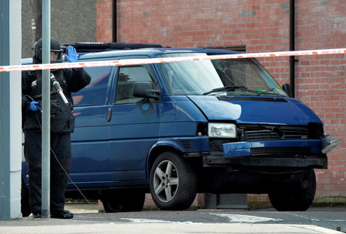 Murder bid: A bomb disposal unit officer inspects the van after a prison officer was injured at his east Belfast home Photo: Getty Images