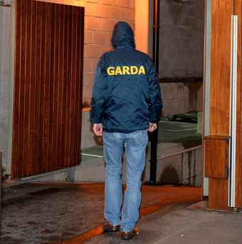 A garda enters the apartment complex where the baby was found. Photo: Domnick Walsh
