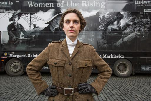 Olwen Jennings as 1916 revolutionary 'Kathleen Lynn' with one of the 'Women of the Rising' buses. Photo: Naoise Culhane