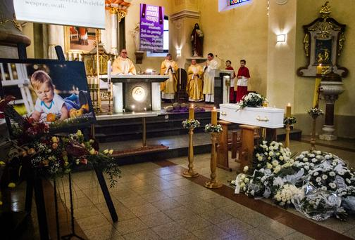 The funeral of 11-month-old baby Karol Rozycki, at the Church of St Martin in Ochaby, Poland