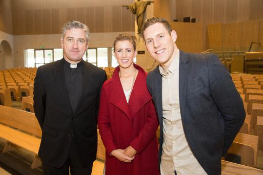 HEALING: John McAreavey, with Fr Richard Gibbons, parish priest of Knock, and John's fiancee, Tara Brennan, before John spoke