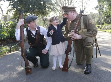 Alice Foynes (3) with actors Gareth McMahon, left, as an Irish Volunteer, and Darren McMahon, as a Royal Fusilier, as the '1916 Easter Rising in St Stephen's Green' exhibition was opened yesterday. Photo: Damien Eagers