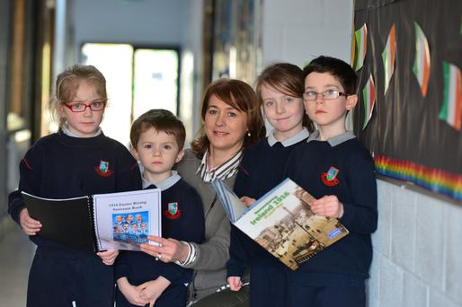 Students of Grange National School, Fermoy, Co Cork : Max O'Connor, Grace Hickey, Millie Cahill,Darragh Howard, with school Secretary Ursula Gubbins preparing for their Proclamation Day events. Photo: Michael Mac Sweeney