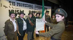 Shannon Sheridan as Padraig Pearse with the Proclamation and (from left) Sara Mebtouche, Kirsten Lee, Megan Rothbaccer, Brianna Nutley, Hannah Crowley, Megan Reilly and Karen Lorla at St Mary's in Glasnevin. Photo: Colin O'Riordan