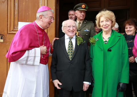 President Michael D Higgins and Sabina Higgins with Archbishop Diarmuid Martin at Dublin's Pro Cathedral. Photo: Frank McGrath