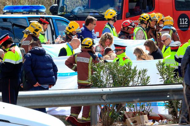 Emergency personnel operate on the Spanish AP-7 motorway near Freginals. Photo: Getty