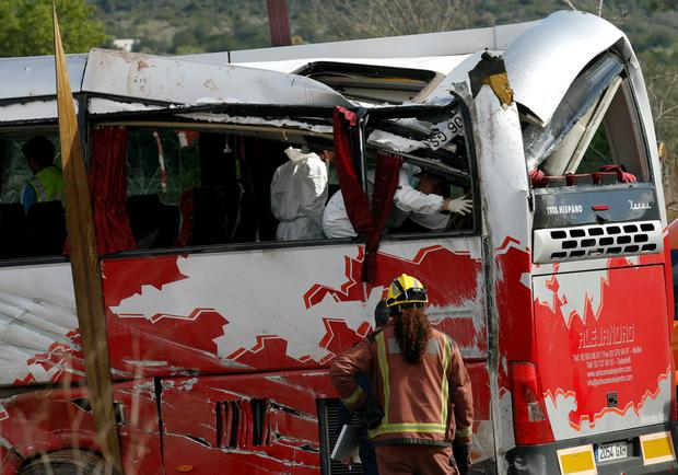 Forensic experts inspect the wreckage of the bus. Photo: Reuters