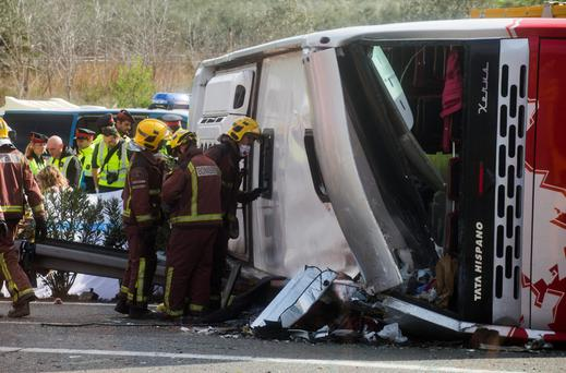 Emergency services personnel at the scene of the coach crash on the AP7 highway along the Mediterranean coast halfway between Valencia and Barcelona in Spain. Photo: AP