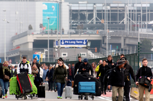 Passengers are evacuated from Zaventem airport after the bomb attack. Photo: Getty