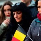 People gather at a makeshift memorial to victims of the terrorist attacks in Brussels. Getty