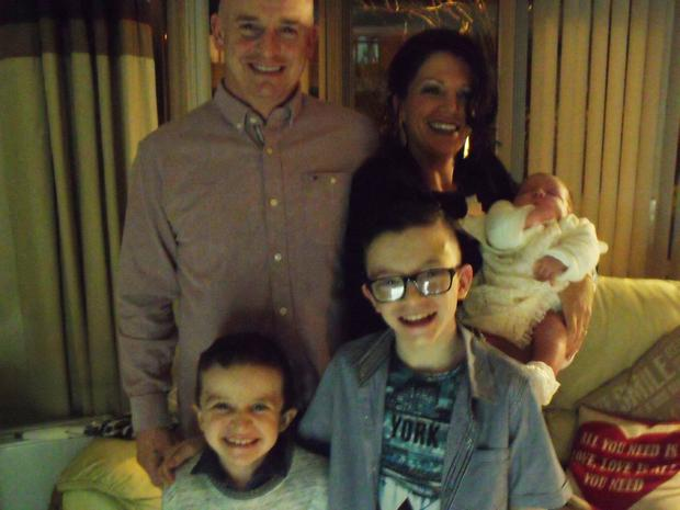Sean McGrotty and Louise James, holding baby Rioghnach-Ann, with sons Evan (8) and Mark (12)