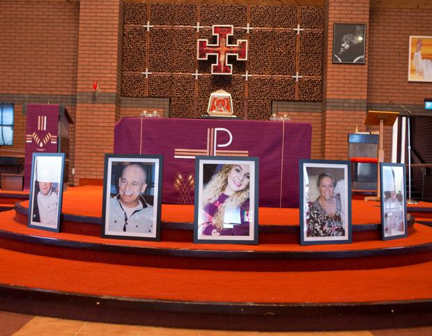 Five portraits of the tragic family adorned the altar at the Holy Family Chapel in Ballymagroarty, Derry, yesterday. Photo: North West Newspix