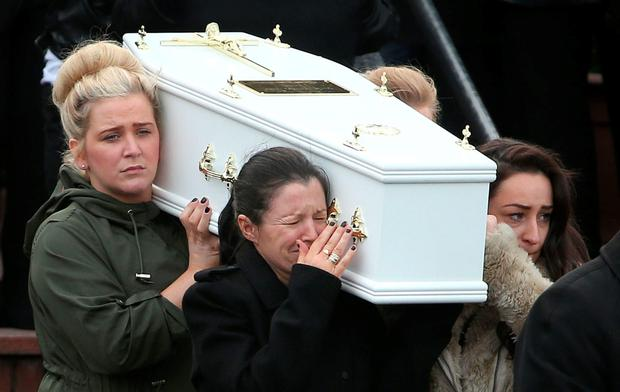 Louise James (front left) breaks down as she carries the coffin of one of her sons. Photo: PA