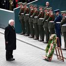 President Michael D Higgins takes a moment to pay his respects during the Wreath laying ceremony for the 100th Anniversary of the 1916 Easter Rising at the GPO on Dublin's O Connell St. Photo: Frank Mc Grath