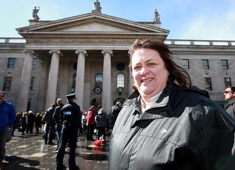 Mary Christian a cousin of Baby Sean Foster, on O'Connell Street yesterday. Photo: Frank McGrath
