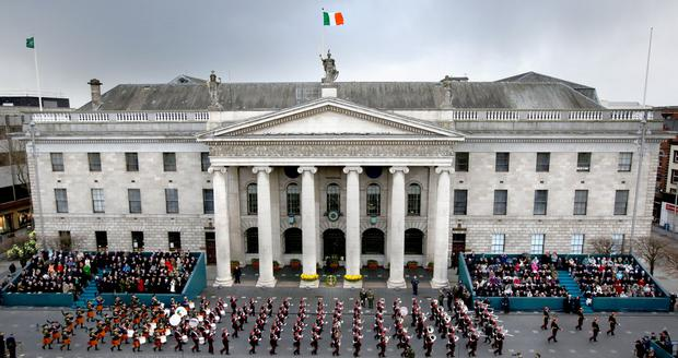 The 1916 Centenary parade makes its way past the GPO in Dublin. Photo: Gerry Mooney