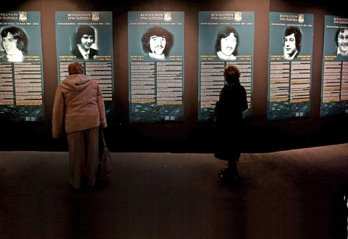 Two women look at images of hunger strikers as part of the '1916 Revolution' exhibition at the Ambassador Theatre in Dublin. Photo: Gerry Mooney