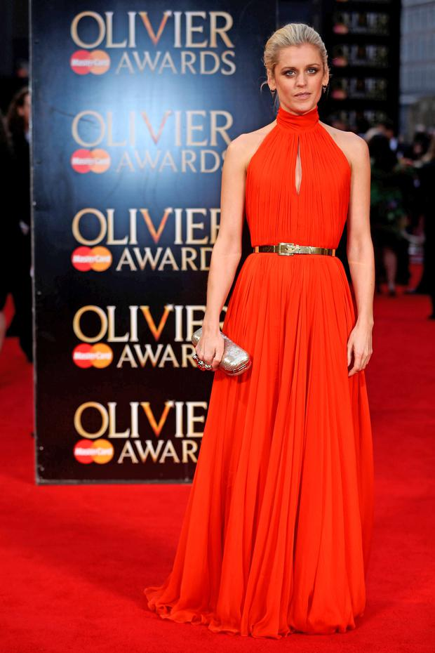 Denise Gough poses on the red carpet on her arrival at the Laurence Olivier Awards in London. Photo: Getty