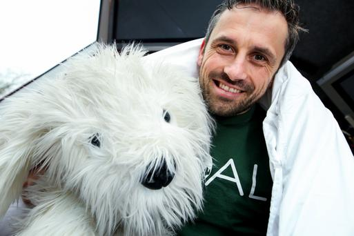 Goal patron Alan Brogan and 'Dozy the Duvet Day Dog' are calling on all companies to sign up for Duvet Day