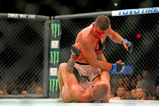 Nate Diaz punches Conor McGregor during the Irish fighter's defeat in Las Vegas last month. Photo: Getty Images