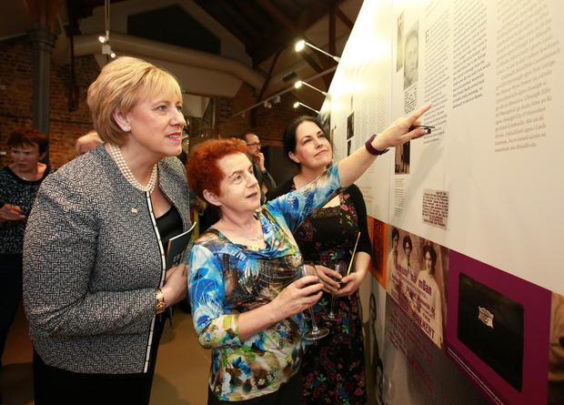Arts Minister Heather Humphreys views the Mná 1916 exhibition with Christina McLoughlin, whose Aunt Mary McLoughlin was a courier in the GPO in 1916, and Helen Mac Mahon, grandniece of Sorcha Mac Mahon, who set up the Irish Volunteers Dependants Fund. Photo: Frank McGrath
