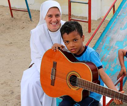 Sister Clare Theresa Crockett with a pupil at the Home of the Mother order school in Ecuador. Photo: Home of the Mother order/PA