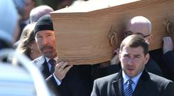 The Edge carrys the coffin from Howth Presbyterian Church after the funeral of his father, Garvin Evans. Picture: Damien Eagers