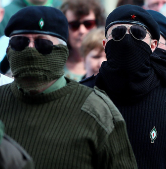 Threat: Some RSF members were masked for the march Photo: PA