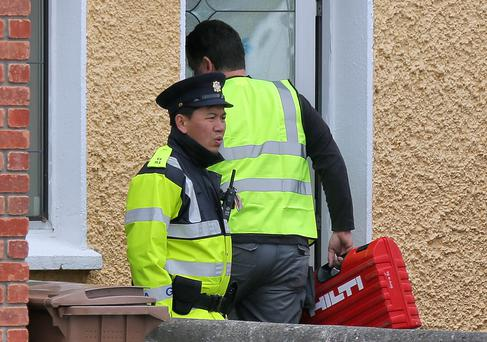 GRISLY: Workers bring equipment to the house where gardai will dig for the bodies of two babies. Photo: Colin Keegan