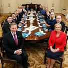 Taoiseach Enda Kenny and Tanaiste Frances Fitzgerald with their fellow Cabinet members pose for an official photo at Aras an Uachtarain. Photo: Maxwells