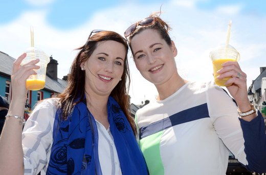 Aoife Scahill and Fiona Kennedy toast the sunny weather in Westport, Co Mayo Photo: Paul Mealey