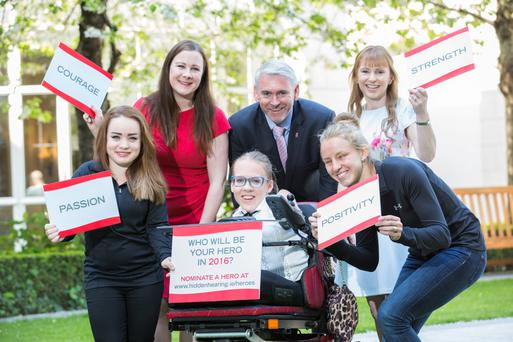 At the launch of Hidden Heroes in Dublin were, from left, Irish paralympian Niamh McCarthy; Neala Dempsey; campaigner Joanne O'Riordan; Stephen Leddy, managing director of Hidden Hearing; Irish paralympian Greta Steimikyte; and Hilary Noonan. Photo: Naoise Culhane